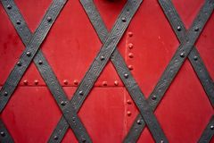 Old riveted metal red painted door Royalty Free Stock Photography