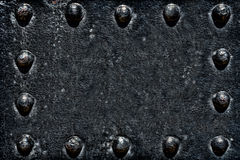 Old Rivets on Black Metal Plate Grunge Background  Stock Photos