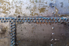 Old rivets on a steel hull. Close shot of a riveted steel hill stock image