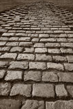 Old road. A cobblestone old road - stone brick way Royalty Free Stock Image
