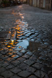 Old road. Trace of water on a paving stone old road Royalty Free Stock Photography