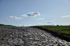 Old road against blue sky. Old stone road against blue sky Stock Photo