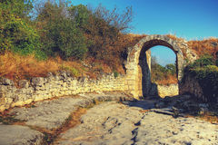 The old road. Ancient ruins. Arch. landscape background Royalty Free Stock Photos