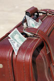 Old road bag with money Stock Image