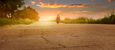 Old road closeup image at sunset time Royalty Free Stock Photos