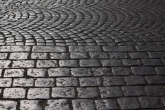 Old road cobblestone Stock Images