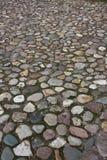 Old road of cobblestones. stock image