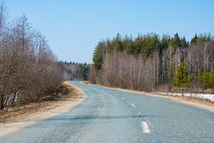 Old Road in countryside in early spring Royalty Free Stock Image