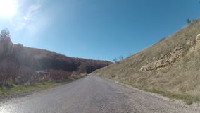 The old road through hilly terrain, GoPro stock video