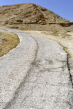 Old road in Judea desert. Ancient bitumen road near Jericho city, Israel Stock Photos
