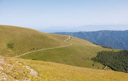 Old road in mountains. The ancient trade route in the Caucasus Mountains. Russia Stock Photography
