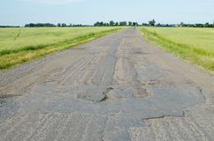 Old road in need of repair. Royalty Free Stock Photography