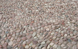 Old road paved with the cobble stones Stock Photos