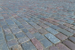 Old road paved with the cobble stones street of Tallinn Royalty Free Stock Photo
