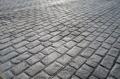 Old road paved with granite stones Royalty Free Stock Image