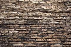 Old road paved with granite stones texture as a background Royalty Free Stock Photography