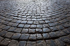 Old road is paved with stone setts Royalty Free Stock Images