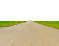 Old road, roadsides and green grass field Royalty Free Stock Photography