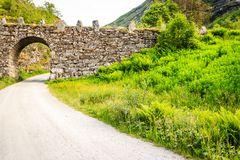 Old road landscape in norwegian mountains Royalty Free Stock Photo