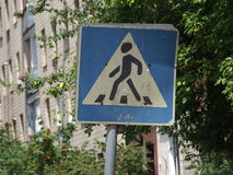 Old road sign of a pedestrian crossing in the city Royalty Free Stock Image