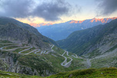 Old road with tight serpentines. On the southern side of the St. Gotthard pass bridging swiss alps at sunset in Switzerland, europe Stock Photography