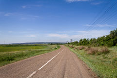 Old road under blue sky Royalty Free Stock Photos