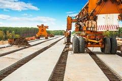 Old roadworking mashines on bridge under construction Stock Photography