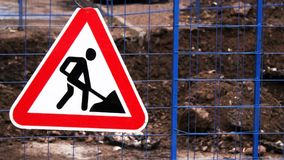 Old Roadworks Sign on a Busy Road in Scotland Stock Image