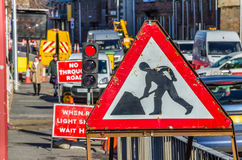 Old Roadworks Sign on a Pavement Stock Photo
