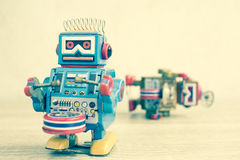 Old robot toy on wood table Stock Photos