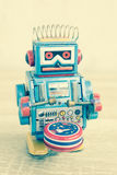 Old robot toy on wood table Royalty Free Stock Image