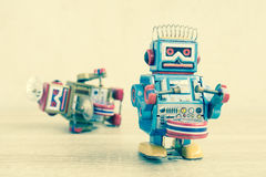 Old robot toy on wood table Stock Images