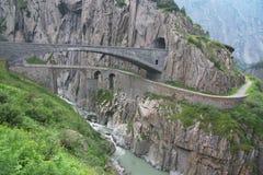 Old rock bridge in alps Royalty Free Stock Photos