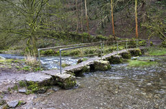 Old Rock Foot Bridge across the River Lathkill Stock Images