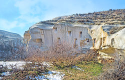 The old rock. The rocky landscape of Cappadocia with the vineyard on the foreground, Turkey Stock Photos