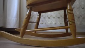 Old rocking chair stock video footage