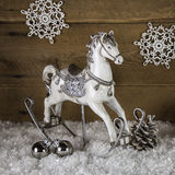 Old rocking horse in white and silver for christmas decoration. Royalty Free Stock Photo