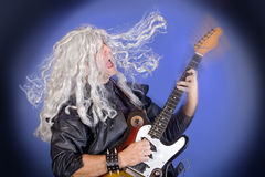 Old rockstar. Playing his electric guitar Stock Photography