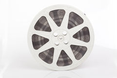 Old roll of movie film. On white stock images