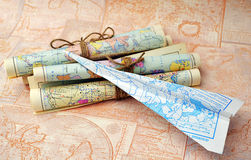 Old rolled maps and paper airplane Royalty Free Stock Photography