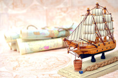 Old rolled maps and souvenirs ship Stock Photography