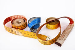 Old rolled measure tapes Stock Photos