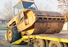 The old roller furling truck concreting of roads. Prepared for transport on a truck with a trailer Stock Photo