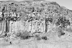 Basalt Rocks Column are volcanic rock outcrops in the form of columnar basalt located in Racos, Romania. In an old roman abandoned career. It is a national stock photo
