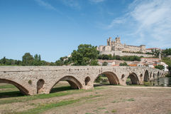 Old roman bridge and cathedral St Nazaire in Beziers Stock Images