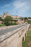 Old roman bridge and cathedral St Nazaire in Beziers Stock Photos