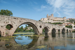 old roman bridge and cathedral St Nazaire in Beziers Royalty Free Stock Images
