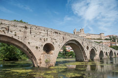 Old roman bridge and cathedral St Nazaire in Beziers Stock Photography