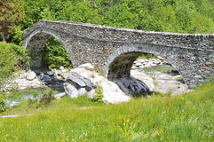 Old roman bridge in Gaby Stock Photos