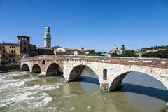 Old roman bridge Ponte di Pietra in Verona  spans the river Etsc Royalty Free Stock Photos